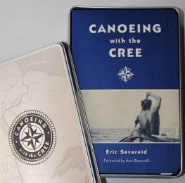 Field guide style book in decorative tin box